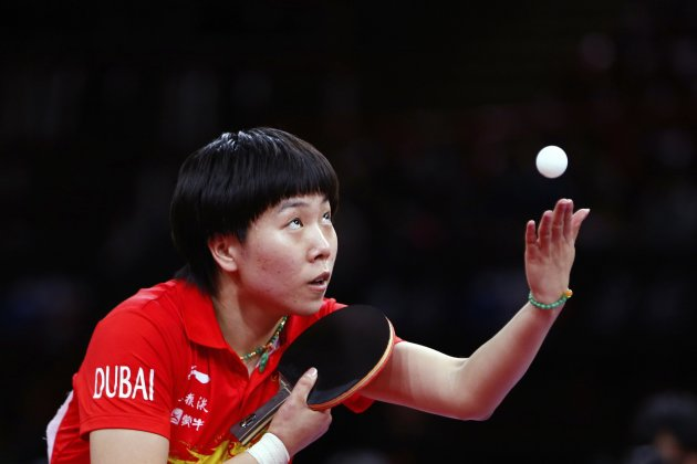 Li of China serves to compatriot Liu during their women's singles final at the World Team Table Tennis Championships in Paris