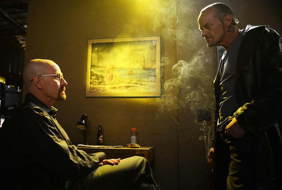 "This image released by AMC shows Walter White, played by Bryan Cranston, left, planning multiple murders with Uncle Jack, played by Michael Bowen, in a scene from season five of ""Breaking Bad."" The series finale of the popular drama series airs on Sunday, Sept. 29. (AP Photo/AMC, Ursula Coyote)"