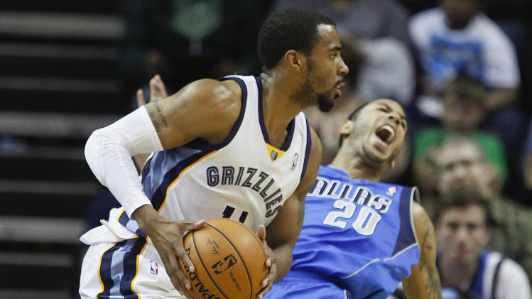 Memphis Grizzlies guard Mike Conley (11) runs into Dallas Mavericks guard Devin Harris (20) in the first half of an NBA basketball game Wednesday, April 16, 2014, in Memphis, Tenn. (AP Photo/Lance Murphey)