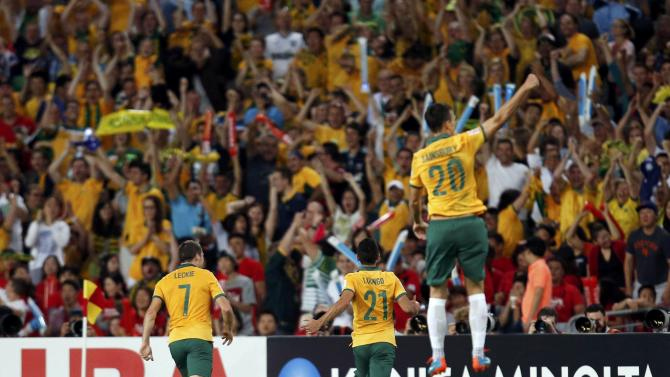 Australia's Massimo Luongo and teammates Mathew Leckie and Trent Sainsbury celebrate after Luongo scored a goal against South Korea during their Asian Cup final soccer match at the Stadium Australia in Sydney