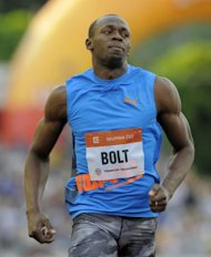 Usain Bolt of Jamaica reacts after competing in the men&#39;s 100m sprint on May 25