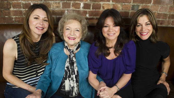 """This Nov. 27, 2012 photo shows """"Hot in Cleveland"""" co-stars, from left, Jane Leeves, Betty White, Valerie Bertinelli and Wendie Malick in New York. Their TV Land sitcom focuses on three slightly past their prime gal-pals from Los Angeles who decide to make a fresh start in Cleveland, where they rent a house whose caretaker, played by White, serves as their salty companion and foil. (Photo by Charles Sykes/Invision/AP)"""