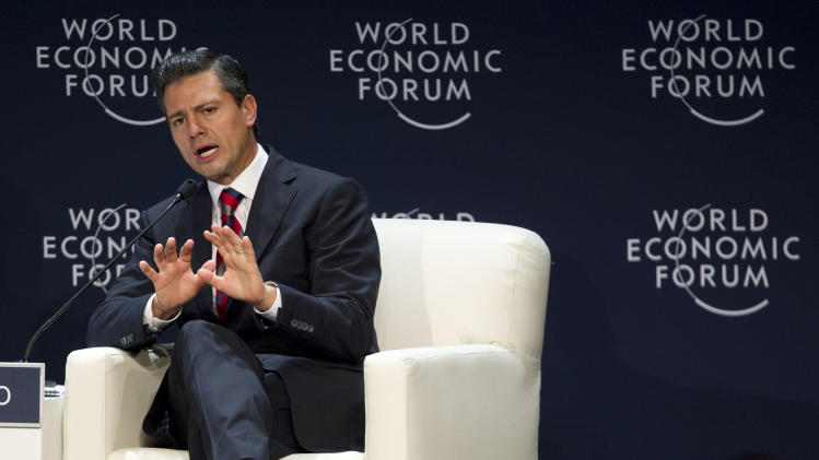 FILE - Mexico's President Enrique Pena Nieto speaks during the inauguration of the World Economic Forum on Latin America in Lima, Peru, in this April 24, 2013 file photo. Mexico is ending the widespread access it gave to U.S. security agencies in the name of fighting drug trafficking and organized crime as the country's new government seeks to change its focus from violence to its emerging economy. The change was confirmed by Mexico's Foreign Ministry on Monday April 29, 2013. (AP Photo/Martin Mejia, File)