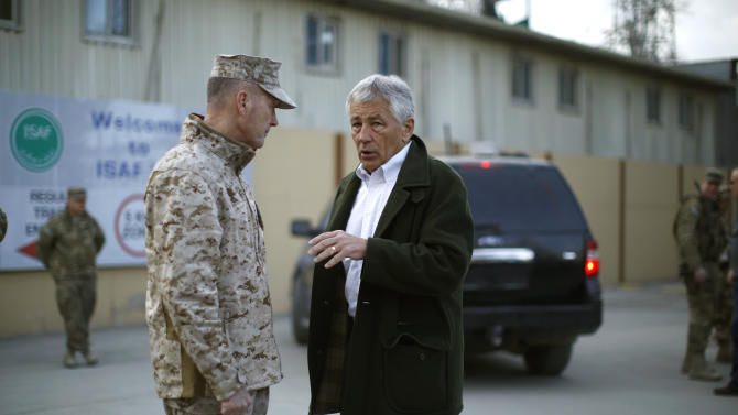 U.S. Secretary of Defense Chuck Hagel speaks with Gen. Joseph Dunford, commander of the International Security Force in Kabul, Afghanistan Monday, March 11, 2013. Hagel rejected any suggestions that the United States is in collusion with the Taliban in Afghanistan with the goal of making Afghans fearful of more violence if foreign troops leave as scheduled next year.  (AP Photo/Jason Reed, Pool)