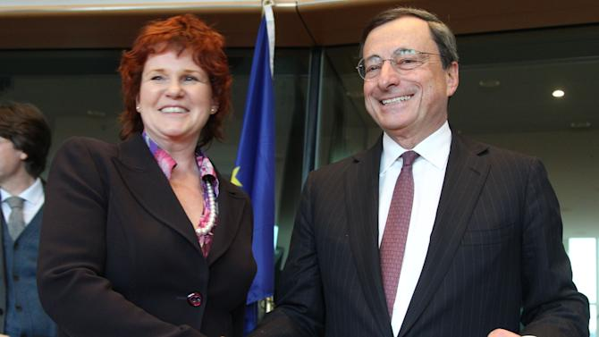 President of the European Central Bank Mario Draghi, right, shakes hands with chairwoman of the Committee Sharon Bowles, of England, prior to the start of the Economic and Monetary Affairs Committee meeting in Brussels, Belgium, Monday Feb. 18, 2013.  (AP Photo/Yves Logghe)