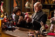 "In this image released by Paramount Pictures, Asa Butterfield portrays Hugo Cabret, left, and Ben Kingsley plays Georges Méliès in a scene from ""Hugo."" (AP Photo/Paramount Pictures, Jaap Buitendijk)"