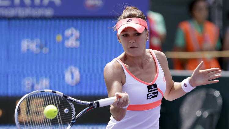 Agnieszka Radwanska, of Poland, returns to Magdalena Rybarikova, of Slovakia, during the Sony Open tennis tournament in Key Biscayne, Fla.,  Saturday, March 23, 2013. (AP Photo/Alan Diaz)