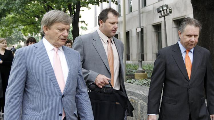 Former Major League Baseball pitcher Roger Clemens, center, and attorney Rusty Hardin, left, arrive at federal court in Washington, Tuesday, May 15, 2012, for Clemens perjury trial. (AP Photo/Charles Dharapak)