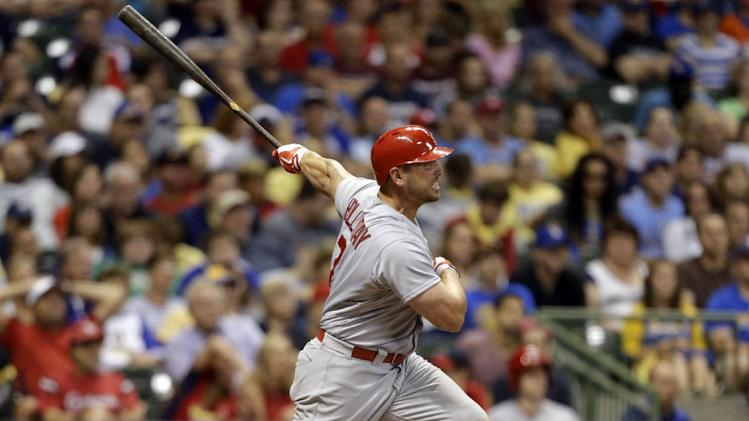 St. Louis Cardinals' Matt Holliday watches his home run against the Milwaukee Brewers during the ninth inning of a baseball game Friday, July 11, 2014, in Milwaukee. (AP Photo/Jeffrey Phelps)