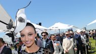 Ladies at Flemington have experimented with the traditional black and white theme on Derby Day
