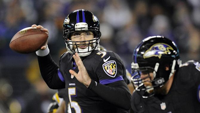 Baltimore Ravens quarterback Joe Flacco (5) throws to a receiver in the first half of an NFL football game against the Pittsburgh Steelers, Thursday, Nov. 28, 2013, in Baltimore