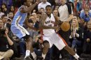 Raptors' Johnson moves around Nuggets' Faried during their NBA basketball game in Toronto