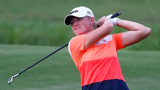 Stacy Lewis plays a shot on the 17th hole during the first round of the Yokohama Tire LPGA Classic at the Robert Trent Jones Golf Trail at Capitol Hill Senator Course on September 18, 2014 in Prattville, Alabama