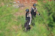 Anti-terror police officers on Sunday examine an area in the town of Depok, in the outskirts of Jakarta, following a bomb blast on September 8. The blast took place late Saturday in a building listed as an orphanage in Depok, national police spokesman Anang Iskandar said in a text message