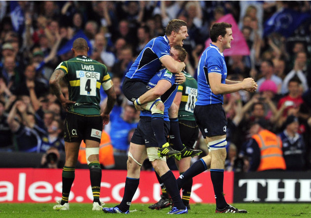 Leinster's Irish centre Brian Driscoll (top) celebrates with Irish Jamie Heaslip (C) after their team won the Heineken Cup Final match against Northampton Saints at the Millennium Stadium in Cardiff o
