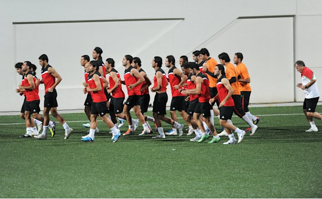 Iraqi footballers, including Iraqi football team coach Brazilian Zico (R) warm up for training at Jalan Besar Stadium in Singapore on September 4, 2011, ahead of the 2014 World Cup Asian qualifying ma