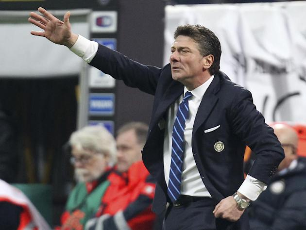 Inter Milan coach Walter Mazzarri gestures during the Serie A soccer match between Inter Milan and Sassuolo at the San Siro stadium in Milan, Italy, Sunday, Feb. 9, 2014