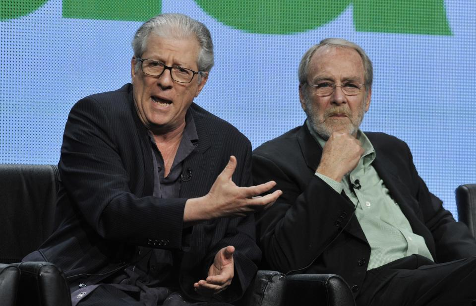"Peter Riegert, left, and Martin Mull, cast members in the FOX series ""dads,"" take part in a panel discussion on the show during the FOX 2013 Summer TCA press tour at the Beverly Hilton Hotel on Thursday, Aug. 1, 2013 in Beverly Hills, Calif. (Photo by Chris Pizzello/Invision/AP)"