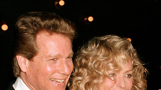 "FILE - In this March 5, 1989 file photo, actors Ryan O'Neal, left, and Farrah Fawcett are shown at the premiere of the film. ""Chances Are,"" in New York. O'Neal sued a former associated of his late partner Farrah Fawcett Thursday, July 14, 2011, claiming the man was the source of allegations that the actor was improperly holding onto an Andy Warhol portrait of actress. (AP Photo/Ray Stubblebine, file)"