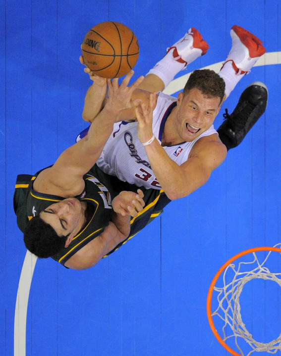 Los Angeles Clippers forward Blake Griffin, right, puts up a shot as Utah Jazz center Enes Kanter, of Turkey, defends during the second half of an NBA basketball game, Saturday, Dec. 28, 2013, in Los