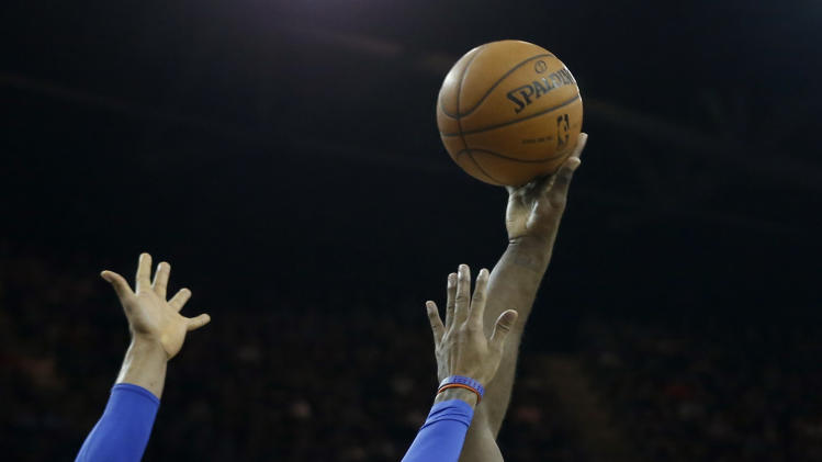Detroit Pistons forward Jason Maxiell, 54, shoots past New York Knicks forward Carmelo Anthony during their NBA basketball game at the 02 arena in London, Thursday, Jan. 17, 2013.  (AP Photo/Matt Dunham)