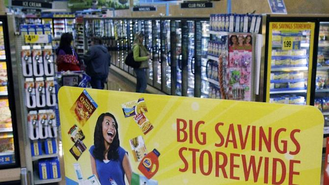 FILE - In this Tuesday, March 1, 2011, file photo, customers shop in the frozen food department at a Kroger Co. supermarket, in Cincinnati. Kroger Co. is raising its earnings outlook for the year after the nation's largest traditional supermarket chain reported a third-quarter profit that topped Wall Street expectations. The company, which also operates Fry's, Food 4 Less and Ralphs, has been working to improve the shopping experienc and build customer loyalty as it fends off competition from specialty grocers such as Whole Foods and big-box retailers such as Target, as well as dollar stores and drugstore chains. (AP Photo/Al Behrman)