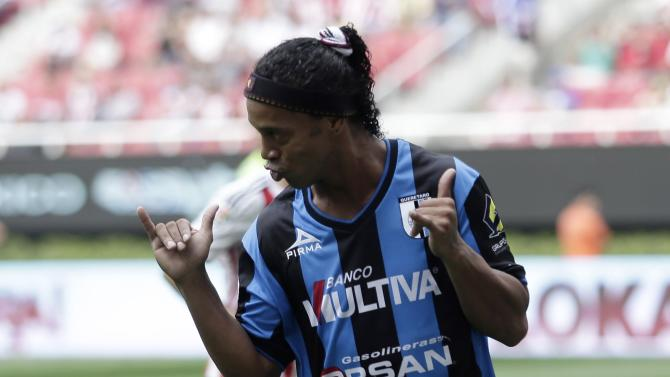 Queretaro's Ronaldinho celebrates after scoring a penalty goal during their Copa MX soccer match against Guadalajara Chivas in Zapopan