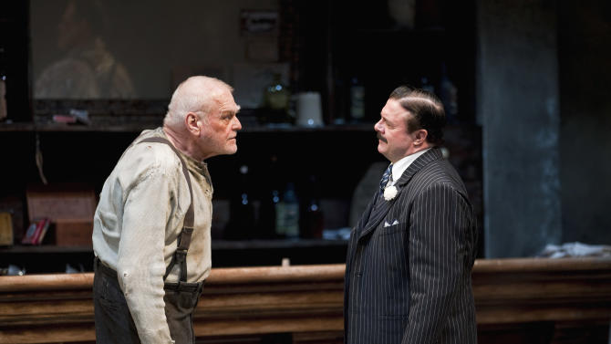 """In this April 20, 2012, production photo provided by the Goodman Theatre in Chicago, actors Brian Dennehy, left, portraying one-time syndicalist-anarchist Larry Slade and Nathan Lane as Theodore """"Hickey"""" Hickman perform in a scene in Eugene O'Neill's """"The Iceman Cometh"""" directed by Robert Falls. The epic drama runs through June 17. (AP Photo/Courtesy of The Goodman Theatre, Liz  Lauren)"""