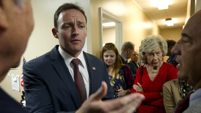 """Patrick Murphy, the Democratic candidate for Florida's 18th Congressional District, talks to supporters during a """"thank you"""" tour of his district, Thursday, Nov. 8, 2012 in Palm Beach Gardens, Fla. Election Day has come and gone and Republican Rep. Allen West is still fighting for votes — in the courtroom. West, the freshman tea party-idol struggling for re-election in South Florida, found himself 2,456 votes behind Democratic rival Patrick Murphy in Tuesday's unofficial tally. (AP Photo/J Pat Carter)"""