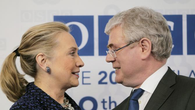 US Secetary of State Hillary Rodham Clinton  is greeted by Irish Foreign Minister Eamon Gilmore at the Organisation for Security and Co-operation in Europe, meeting in Dublin Thursday Dec. 6, 2012. (AP Photo/Julien Behal/PA)  UNITED KINGDOM OUT