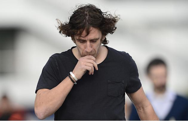 FC Barcelona's Carles Puyol arrives for a press conference to announce his retirement as a FC Barcelona's soccer player at the Sports Center FC Barcelona Joan Gamper in San Joan Despi, Spain,