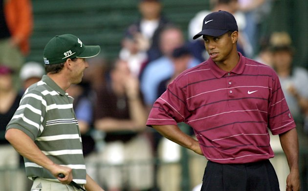 FILE - In this June 16, 2002 file photo, Sergio Garcia, left, and Tiger Woods talk on the 11th hole while waiting for play to resume after a rain delay during the final round of the U.S. Open Golf Cha
