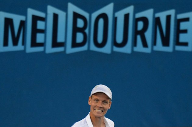 Czech Republic's Tomas Berdych smiles as he celebrates after victory in men's singles match against Kevin Anderson of South Africa on the seventh day of the Australian Open tennis tournament in Melbourne on January 20, 2013.