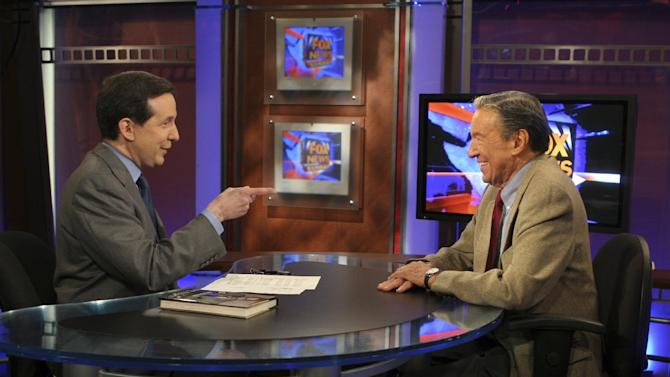 """FILE - This Nov. 3, 2005 file photo provided by Fox TV News shows """"Fox News Sunday"""" host Chris Wallace, left, pointing at his father, Mike Wallace, a CBS """"60 Minutes"""" correspondent, during taping of the television show in New York. Their talk represents the first time father and son had crossed paths professionally in careers that together stretches three-quarters of a century. Mike Wallace, the dogged, merciless reporter and interviewer who took on politicians, celebrities and other public figures in a 60-year career highlighted by the on-air confrontations that helped make """"60 Minutes"""" the most successful primetime television news program ever, has died. He was 93. (AP Photo/ Fox News,2MK Studio, File)"""