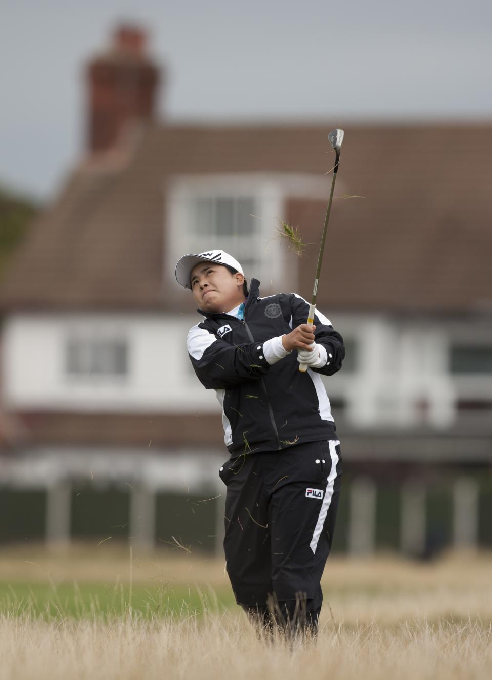Korea's Inbee Park plays out of the rough on the 3rd hole during her final round at the Women's British Open golf championships at Royal Liverpool Golf Club, Hoylake, England, Sunday Sept. 16, 2012.  (AP Photo/Jon Super)