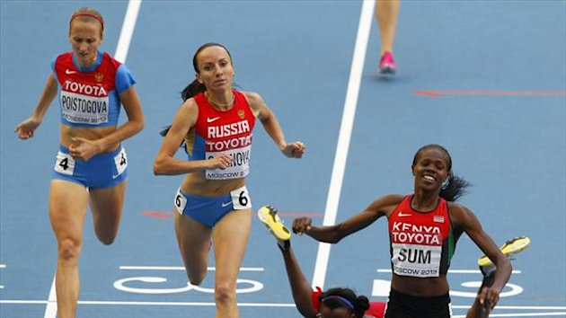 Eunice Jepkoech Sum of Kenya (R) celebrates winning the women's 800 metres final ahead of Ekaterina Poistogova of Russia (L) and second place finisher Mariya Savinova of Russia (2nd L) as Alysia Johnson Montano of the US falls (Reuters)