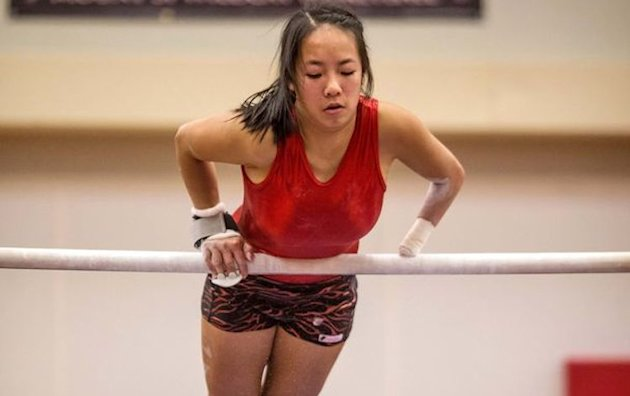 "Amelia ""Millie"" Andrilenas is Kirkland (Wash.) Juanita High's top gymnast despite only having one hand -- Dean Rutz/The Seattle Times"