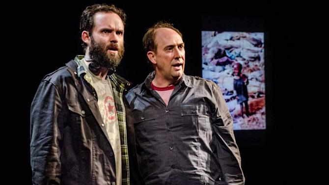 """This theater image released by Portland Center Stage via Columbia University  shows Danny Wolohan as Dan O'Brien, left, and William Salyers as Paul Watson during a performance of """"The Body of an American"""" by Dan O'Brien. O'Brien's """"The Body of an American"""" and Robert Schenkkan's """"All the Way"""" have been named the inaugural winners of a theater award honoring the late Sen. Edward Kennedy. Columbia University on Friday said both playwrights will get the award as well as $100,000 each, one of the largest prizes given for dramatic writing.  (AP Photo/Portland Center Stage via Columbia University, Patrick Weishanpel)"""