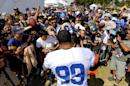 Los Angeles Rams defensive tackle Aaron Donald gibes autographs for fans during the NFL football team's training camp, Saturday, July 30, 2016, in Irvine, Calif. (AP Photo/Ryan Kang)