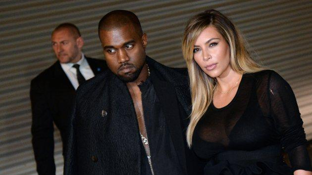 Kanye West and Kim Kardashian pose prior to Givenchy 2014 Spring/Summer ready-to-wear collection fashion show, on September 29, 2013 in Paris -- Getty Images