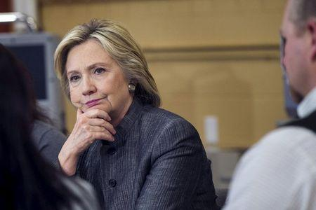 U.S. presidential candidate and former Secretary of State Hillary Clinton participates in a discussion in a classroom in New Hampshire