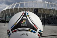 The Euro 2012 official matchball in front of the Olympic Stadium in Kiev. With just a month left until Euro 2012 kicks off in Warsaw, Poland is working flat-out and watching nervously as calls to boycott matches in co-host Ukraine tarnish the tournament