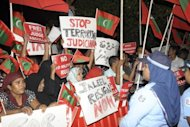 Image provided by Haveeru News Service shows demonstrators gathered outside the police and military headquarters in Male on January 21 during a protest against the arrest of senior judge Abdullah Mohamed