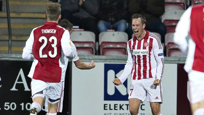 Aalborg's Enevoldsen celebrates his goal against Steaua Bucuresti during their UEFA Europa League Group match in Aalborg