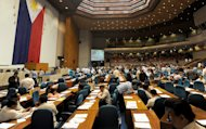 This file photo shows members of the Philippine house of representatives meeting to vote ahead of schedule to terminate heated debates on a controversial birth control law after President Benigno Aquino urged its speedy passage, in Quezon City, on August 6, 2012. Both chambers of parliament passed the final version of the act on December 19
