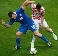 Italian forward Antonio Cassano (L) clashes with Croatian midfielder Darijo Srna during their Euro 2012 championships football match at the Municipal Stadium in Poznan. The match ended 1-1