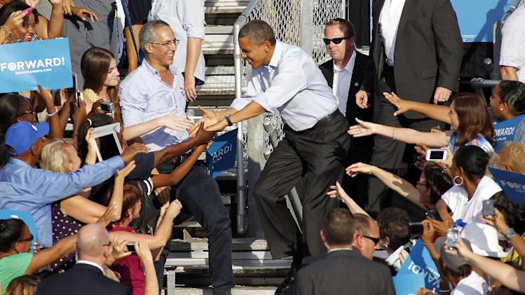 President Barack Obama is greeted by supporters during a campaign event at McArthur High School in Hollywood, Fla., Sunday, Nov. 4, 2012. (AP Photo/Terry Renna)