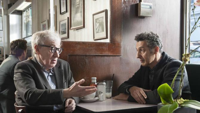 """This publicity image released by Toronto International Film Festival shows Woody Allen, left, and John Turturro in """"Fading Gigolo,"""" a film being showcased at the Toronto International Film Festival. (AP Photo/Toronto International Film Festival)"""