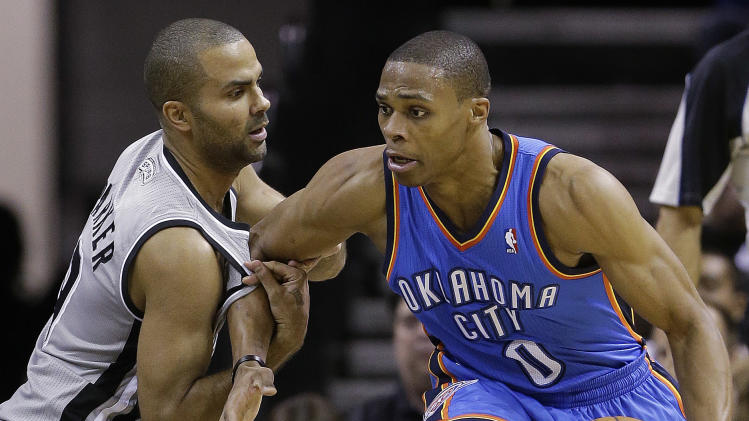 Oklahoma Thunder's Russell Westbrook (0) is pressured by San Antonio Spurs' Tony Parker, left, of France, during the second quarter of an NBA basketball game, Thursday, Nov. 1, 2012, in San Antonio. (AP Photo/Eric Gay)