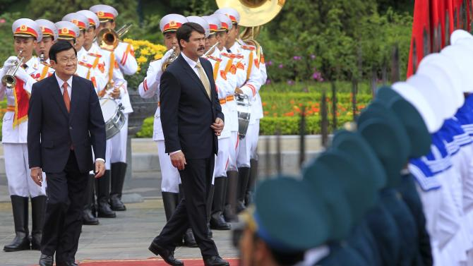 Hungary's President Ader reviews the guard of honour with his Vietnamese counterpart Truong during a welcoming ceremony at the Presidential Palace in Hanoi